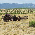 Old Tractor And Rake In New Mexico by Jeff Swan