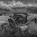 Old Truck Abandoned In The Grass In Black And White At The Ghost Town By Okaton South Dakota by Randall Nyhof