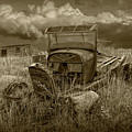 Old Truck Abandoned In The Grass In Sepia Tone by Randall Nyhof