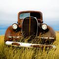 Old Truck In Field by Emilio Lovisa