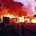 Old Tucson Arizona In Flames 1995  by David Lee Guss
