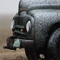 Old Vintage Truck In Winter Storm Saskatchewan by Mark Duffy