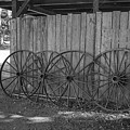 Old Wagon Wheels Black And White by Kathy Baccari