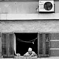 Old Woman In Window  by Yara S