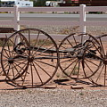 Old Wooden Wagon Against White Fence  by Colleen Cornelius