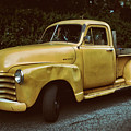 Old Yellow Pickup by Mark Miller