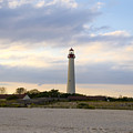 On The Beach At Cape May Lighthouse by Bill Cannon