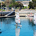 One-person Sailboats By The Commercial Pier In Monterey-california by Ruth Hager
