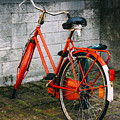 Orange Bicycle In The Street by Pati Photography