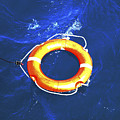 Orange Life Buoy In Blue Water by Jacki Costi