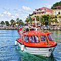 Orange Lifeboats Across Colorful Bay by Darryl Brooks
