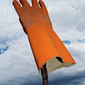 Orange Rubber Glove On A Wooden Post Against A Cloudy Sky by Sami Sarkis