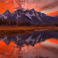 Orange Skies Over The Tetons by Adam Jewell