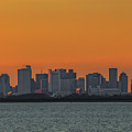 Orange Sky During Sunset With The Boston Skyline by Brian MacLean