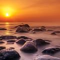 Orange Sunset Long Exposure Over Sea And Rocks by Sandra Rugina