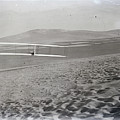 Orville Making Right Turn Showing Warping Of Wings Hill Visible In Front Of Him Kitty Hawk North Car by R Muirhead Art