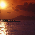 Outrigger Canoe At Sunset by Joe Carini - Printscapes