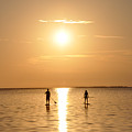 Paddle Boarding Out Of The Sunset by Bill Cannon