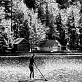Paddleboarding On Old Forge Pond by David Patterson