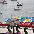 Paddleboats Waiting In The Inner Harbor At Baltimore by William Kuta