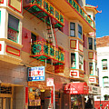 Painted Balconies In San Francisco Chinatown by James Kirkikis