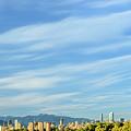 Blue Sky Over Vancouver City Skyline. by Viktor Birkus
