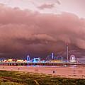 Panorama Of Historic Galveston Pleasure Pier With Approaching Storm Above Galveston Seawall Texas by Silvio Ligutti