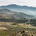 Panoramic View Of Monte Grosso And The Mountains Of Corsica by Jon Ingall