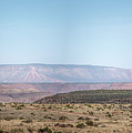 Panoramic View Of Open Desert Field In Nevada With Grand Canyon  by PorqueNo Studios
