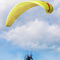 Paraglider Floating In The Clouds by Bob Zuber
