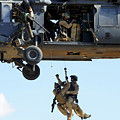 Pararescuemen Are Hoisted Into An Hh-60 by Stocktrek Images