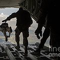 Paratroopers Jump Out Of A Kc-130j by Stocktrek Images