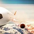 Passenger Airplane Flying At Sunshine, Blue Sky. by Michal Bednarek