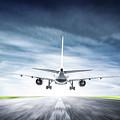 Passenger Airplane Taking Off On Runway by Michal Bednarek
