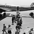 Passengers Boarding A Plane by H. Armstrong Roberts/ClassicStock