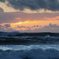Pastel Sunset Over Stormy Waves by Sharon Foelz