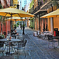 Patio Cafe In Nola by Judy Vincent