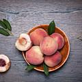 Peaches On A Dark Wooden Background by Sergei Dolgov
