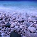 Pebble Shore Of Georgian Bay In Winter by Oleksiy Maksymenko