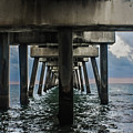 Peering Beneath The Pier by Gary Keesler