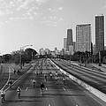 People Cycling On A Road, Bike The by Panoramic Images