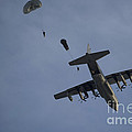 Personnel Jump From A C-130 Hercules by Stocktrek Images