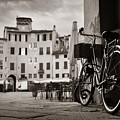 Piazza Dell Anfiteatro With Bike by Songquan Deng