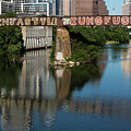 Picturesque View Of The Railroad Graffiti Bridge Over Lady Bird Lake As Canoes And Kayakers Paddle Under The Bridge On A Beautiful Summers Day by Austin Welcome Center