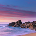 Pink Clouds And Rocky Headland Seascape by Merrillie Redden