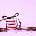 Pink Macarons Tied With Ribbon  by Milleflore Images