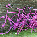 Pink Painted Bikes And Old Wall by Compuinfoto