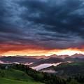 Pink Sunrise And Blue Clouds In The Mountains Of Kamnik Savinja  by Reimar Gaertner