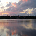 Pink Sunrise With Dramatic Clouds And Steeple On Jamaica Pond by Giora Hadar