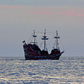 Pirate Ship At Sunset by D Hackett